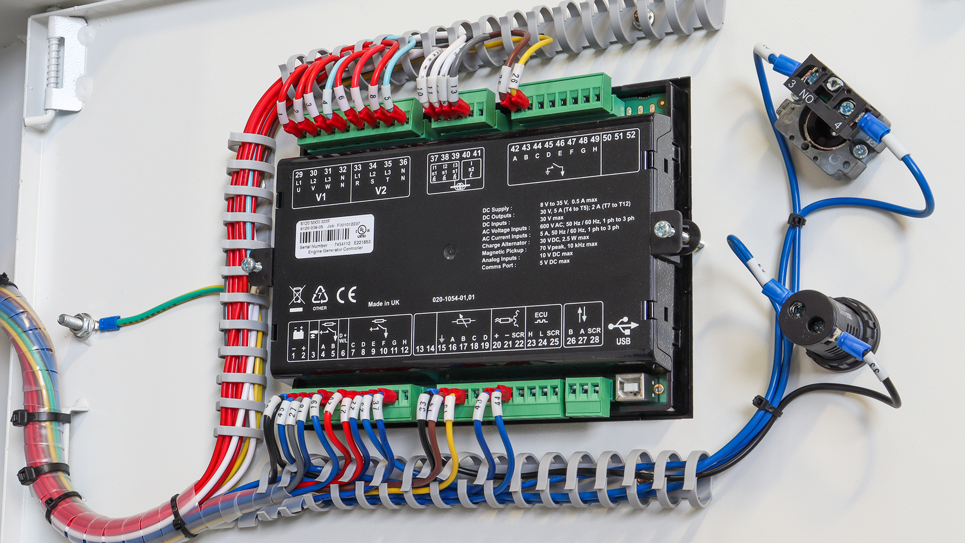 Terminal rail and rear view of Deep Sea Electronics control panel on 175kw Evopower generator