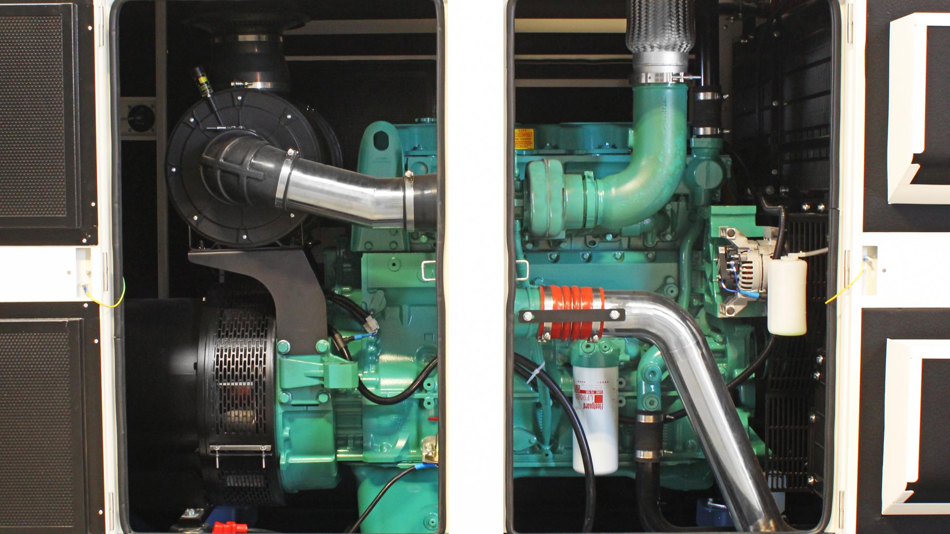 Canopy doors open showing Cummins genset engine 6ZTAA13